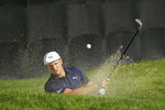 Bryson DeChambeau follows his shot out of a bunker onto the 18th green of the Silverado Resort North Course during the first round of the Safeway Open PGA golf tournament Thursday, Sept. 26, 2019, in Napa, Calif. (AP Photo/Eric Risberg)