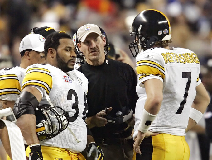 FILE - In this Sunday, Feb. 5, 2006 file photo, Pittsburgh Steelers head coach Bill Cowher talks with Jerome Bettis (36) and quarterback Ben Roethlisberger (7) in the second quarter against the Seattle Seahawks in the Super Bowl XL football game in Detroit. Former Pittsburgh Steelers coach Bill Cowher has been elected to the Pro Football Hall of Fame. Cowher, an analyst for CBS, was surprised by the announcement made live on air in studio before the Tennessee Titans-Baltimore Ravens AFC divisional round playoff game Saturday night, Jan. 11, 2020. (AP Photo/David J. Phillip)