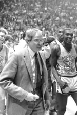 FILE - In this March 24, 1984, file photo, Wake Forest coach Carl Tacy, left, leaves the court with members of his team following their 73-71 victory over DePaul in the semifinals of the NCAA Midwest Regional in St. Louis, Mo. ASt right is Wake Forest's Kenny Green (21). Former Wake Forest and Marshall basketball coach Carl Tacy has died at 87. Tacy's son, Carl Jr., told The Associated Press his father died early Thursday, April 2, 2020. (AP Photo/File)