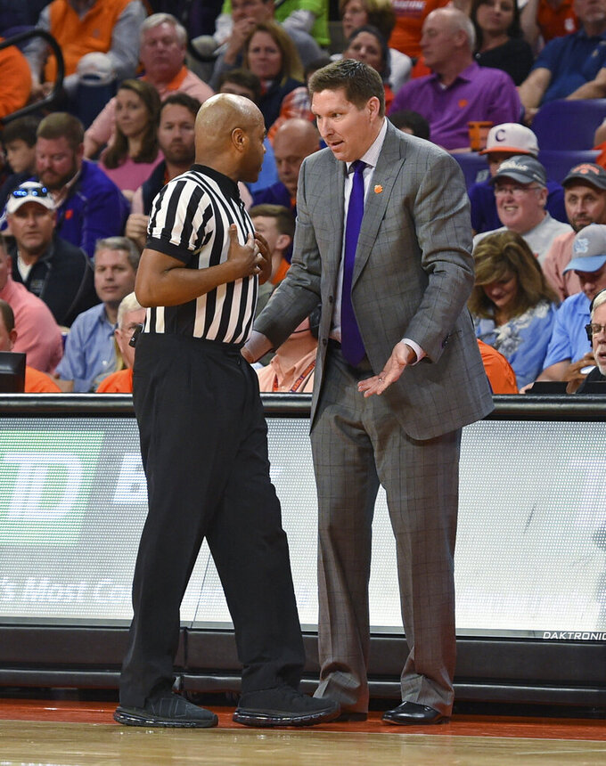 Clemson coach Brad Brownell discusses a call with an official during the first half of the team's NCAA college basketball game against North Carolina on Saturday, March 2, 2019, in Clemson, S.C. (AP Photo/Richard Shiro)