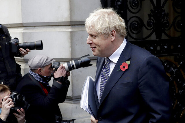 British Prime Minister Boris Johnson walks back into Downing Street after attending a weekly cabinet meeting at the Foreign, Commonwealth & Development Office, in London, Tuesday, Nov. 10, 2020. (AP Photo/Matt Dunham)