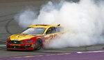 Joey Logano celebrates with a burnout after winning a NASCAR Cup Series auto race at Michigan International Speedway, Monday, June 10, 2019, in Brooklyn, Mich. (AP Photo/Carlos Osorio)
