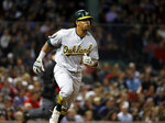 Oakland Athletics' Khris Davis watches his home run against the Boston Red Sox during the eighth inning of a baseball game at Fenway Park in Boston Monday, May 14, 2018. (AP Photo/Winslow Townson)