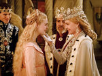 This image released by Disney shows, from left, Harris Dickinson as Prince Phillip, Elle Fanning as Aurora, Robert Lindsay as King John and Michelle Pfeiffer as Queen Ingrith in a scene from the film,