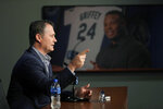 With a photo of Seattle Mariners legend Ken Griffey Jr. in the background, manager Scott Servais speaks Thursday, Jan. 23, 2020, in Seattle during the Seattle Mariners annual news conference before the start of Spring Training baseball. (AP Photo/Ted S. Warren)