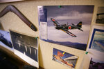A picture of a Japanese Zero plane that attacked Don Long in 1941 is displayed with other mementos on a wall at his home Friday, Dec. 7, 2018, in Napa, Calif. Retired U.S. Navy Cmdr. Don Long wasn't at Pearl Harbor when Japanese war planes started bombing Hawaii on December 7, 1941, he was on the opposite side of Oahu standing watch aboard an anchored military seaplane in Kaneohe Bay. But the wave of bombs and bullets reached his military installation soon after Pearl Harbor was struck, and the young sailor watched from afar as buildings and planes started to explode all around him. On the 77th anniversary of the attack, Long will remember from his home where the 97-year-old survivor will reflect and honor those who died. (AP Photo/Eric Risberg)