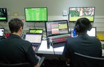 Staff monitor game data and work on match analysis at an operations room during the Wimbledon Tennis Championships in London, Wednesday, July 3, 2019. The All England Club is adding technology enhancements at this year's tournament aimed at eliminating bias from highlights that are chosen by computer artificial intelligence. (AP Photo/Kelvin Chan)