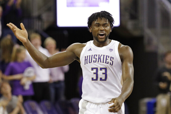 Washington's Isaiah Stewart reacts to scoring against Mount St. Mary's late in the second half of an NCAA college basketball game Tuesday, Nov. 12, 2019, in Seattle. Washington won 56-46. (AP Photo/Elaine Thompson)