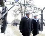Survivors of Auschwitz gather on the 74th anniversary of the liberation of the former Nazi German death camp in Oswiecim, Poland, on Sunday, Jan. 27, 2019. They wore striped scarves that recalled their uniforms, some with the red letter