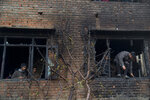 A burnt peach tree stands by a house damaged in a gunbattle in Tral, south of Srinagar, Indian controlled Kashmir, Friday, May 24, 2019. Government forces in Indian-controlled Kashmir killed a top militant commander linked to al-Qaida in the disputed region, officials said on Friday. (AP Photo/ Dar Yasin)