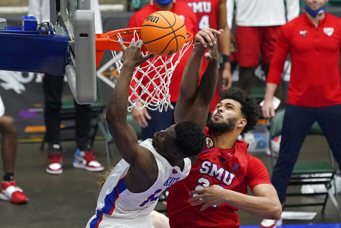 SMU forward Isiah Jasey blocks a shot by Boise State guard Emmanuel Akot, left, during the first half of an NCAA college basketball game in the first round of the NIT, Thursday, March 18, 2021, in Frisco, Texas. (AP Photo/Tony Gutierrez)