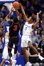 Kentucky's Immanuel Quickley (5) blocks the shot of Georgia's Christian Brown (3) during an NCAA college basketball game in Lexington, Ky., Tuesday, Jan 21, 2020. (AP Photo/James Crisp)