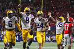 LSU cornerback Derek Stingley Jr. (24) celebrates with teammates his interception against Georgia during the second half of the Southeastern Conference championship NCAA college football game, Saturday, Dec. 7, 2019, in Atlanta. (AP Photo/John Bazemore)