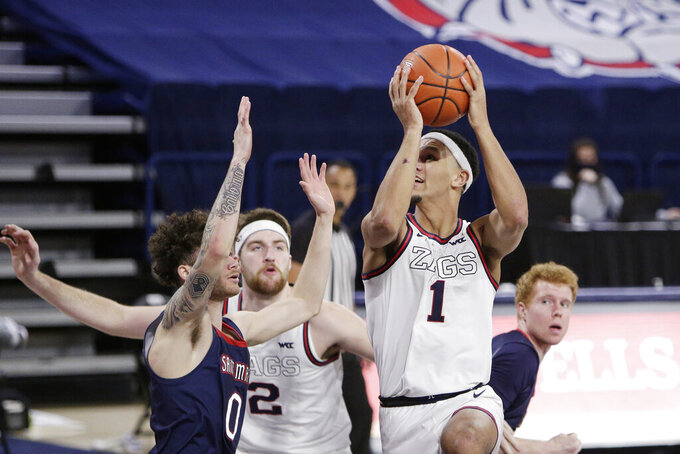 Gonzaga guard Jalen Suggs (1) shoots over Saint Mary's guard Logan Johnson (0) during the second half of an NCAA college basketball game in Spokane, Wash., Thursday, Feb. 18, 2021. (AP Photo/Young Kwak)