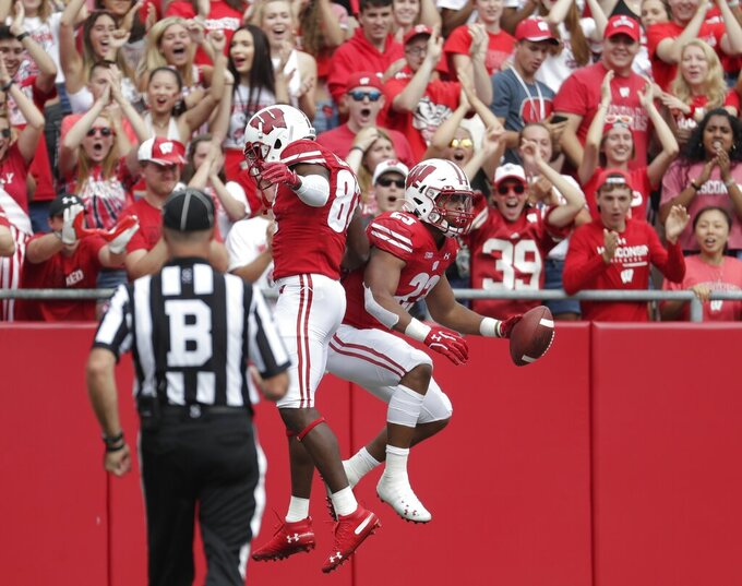 Wisconsin's Jonathan Taylor is congratulated by Quintez Cephus after a touchdown catch during the first half of an NCAA college football game against Central Michigan Saturday, Sept. 7, 2019, in Madison, Wis. (AP Photo/Morry Gash)
