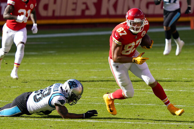 Kansas City Chiefs tight end Travis Kelce (87) runs past Carolina Panthers defensive back Myles Hartsfield (38) during the first half of an NFL football game in Kansas City, Mo., Sunday, Nov. 8, 2020. (AP Photo/Jeff Roberson)