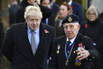Britain's Prime Minister Boris Johnson, left, attends a remembrance service on Armistice Day, the 101st anniversary of the end of the First World War, in Wolverhampton, England, Monday,  Nov. 11, 2019, while on the General Election campaign trail. (Ben Stansall/Pool Photo via AP)