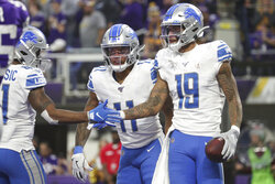 Detroit Lions wide receiver Kenny Golladay (19) is congratulated by running back J.D. McKissic (41) and wide receiver Marvin Jones (11) during an NFL game against the Minnesota Vikings, Sunday, Dec. 8, 2019 in Minneapolis. The Vikings defeated the Lions 20-7. (Margaret Bowles via AP)