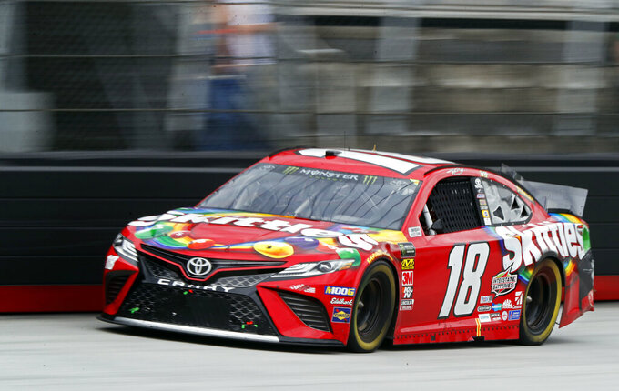 Kyle Busch (18) comes down the back stretch during a NASCAR Cup Series auto race, Sunday, April 7, 2019, in Bristol, Tenn. (AP Photo/Wade Payne)