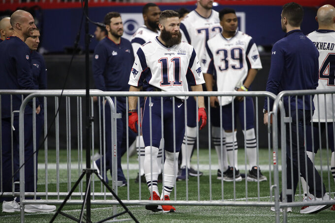 New England Patriots' Julian Edelman steps onto the field during a NFL football walkthrough, Saturday, Feb. 2, 2019, in Atlanta, ahead of Super Bowl 53 against the Los Angeles Rams. (AP Photo/Matt Rourke)