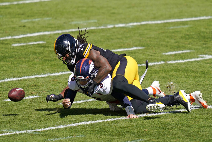 Pittsburgh Steelers outside linebacker Bud Dupree (48) forces a fumble by Denver Broncos quarterback Drew Lock (3) during the first half of an NFL football game, Sunday, Sept. 20, 2020, in Pittsburgh. The Steelers recovered the fumble and Lock was injured on the play. (AP Photo/Keith Srakocic)