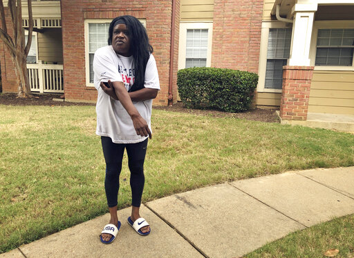 Tracey Haley, the mother of a letter carrier who shot a supervisor and a manager before killing himself in a Tennessee postal facility, speaks with reporters outside of her son's apartment on Thursday, Oct. 14, 2021, in Cordova, Tenn.  Haley told The Associated Press Thursday that her 28-year-old son Johntra Haley was a non-violent person who had been bullied at work. (AP Photo/Adrian Sainz)