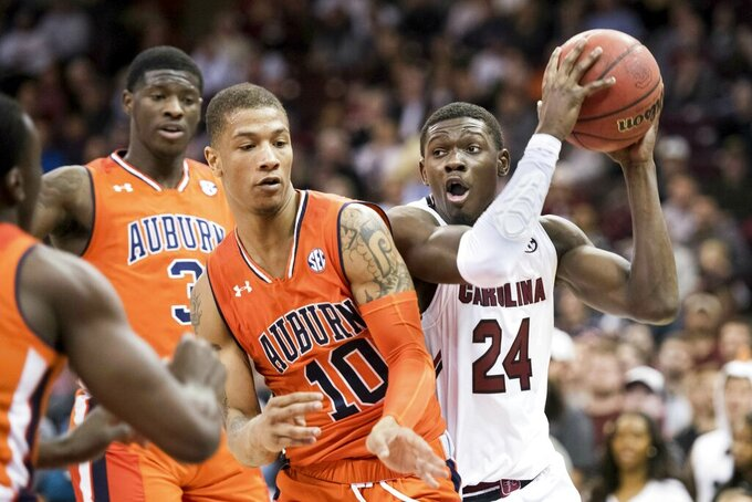South Carolina forward Keyshawn Bryant (24) drives to the hoop against Auburn guard Samir Doughty (10) during the second half of an NCAA college basketball game Tuesday, Jan. 22, 2019, in Columbia, S.C. South Carolina defeated Auburn 80-77. (AP Photo/Sean Rayford)