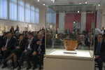An ancient Greek drinking cup decorated with runners, which was one of the awards presented to Spyros Louis, the Greek winner of the Marathon in the 1896 first modern Olympic Games in Athens, is seen at the National Archaeological Museum in Athens on Wednesday, Nov. 13, 2019. Greece's Culture Ministry said Wednesday the ancient vase has been returned to Athens by the University of Muenster in Germany where it had ended up.(AP Photo/Petros Giannakouris)