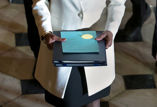 Clerk of the House Cheryl Johnson carries the articles of impeachment against President Donald Trump to the Senate, on Capitol Hill in Washington, Wednesday, Jan. 15, 2020. (AP Photo/J. Scott Applewhite)