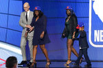 NBA Commissioner Adam Silver escorts relatives of former Kentucky guard Terrence Clarke after a tribute to Clarke during the NBA basketball draft, Thursday, July 29, 2021, in New York. Clarke was killed in a car accident in April 2021. (AP Photo/Corey Sipkin)