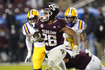 Texas A&M running back Isaiah Spiller (28) carries against LSU during the fourth quarter of an NCAA college football game Saturday, Nov. 28, 2020, in College Station, Texas. (AP Photo/Sam Craft)