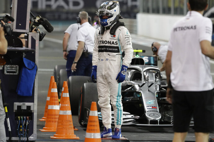 Mercedes driver Valtteri Bottas of Finland at the end of the second free practice at the Yas Marina racetrack in Abu Dhabi, United Arab Emirates, Friday, Nov. 29, 2019. The Emirates Formula One Grand Prix will take place on Sunday. (AP Photo/Luca Bruno)