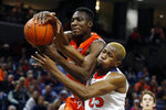 Syracuse forward Bourama Sidibe (34) and Virginia forward Mamadi Diakite (25) battle for a rebound during the first half of an NCAA college basketball game in Charlottesville, Va., Saturday, Jan. 11, 2020. (AP Photo/Steve Helber)