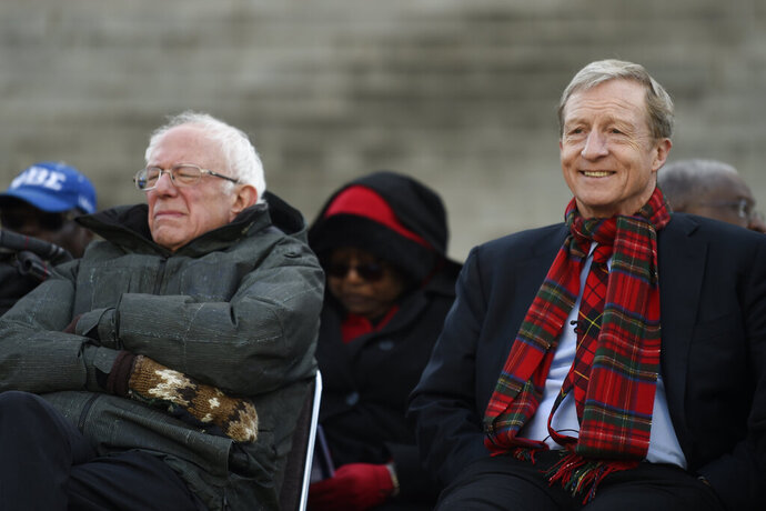 "FILE - In this  Jan. 20, 2020, file photo Democratic presidential candidates Sen. Bernie Sanders, I-Vt., left, and businessman Tom Steyer sit together at the beginning of a Martin Luther King Jr. Day rally in Columbia, S.C. With more visible support among black voters than seen in his 2016 South Carolina campaign, coupled with momentum from earlier contests, fierce competition for the crucial support of black voters and a wildcard GOP effort, Sanders could be poised either for an upset victory or a close second-place finish, a damaging blow to the ""firewall"" of support needed by Joe Biden in the state. If either scenario were to become reality following the Feb. 29 vote, Sanders may have Steyer to thank for eating into the former vice president's support among black voters. (AP Photo/Meg Kinnard, File)"