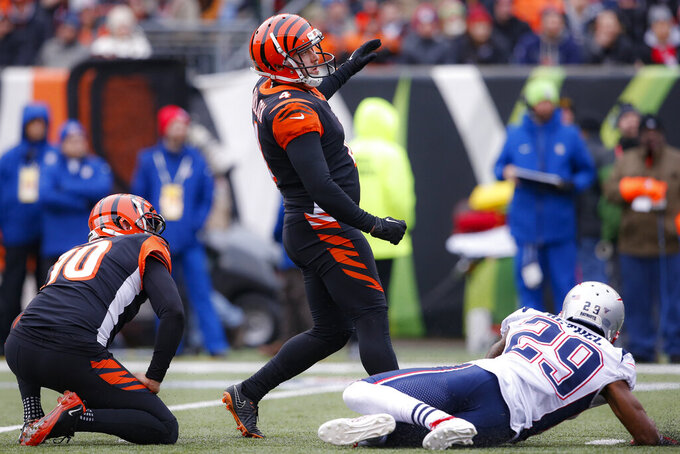 Cincinnati Bengals kicker Randy Bullock (4) watches his field goal in the first half of an NFL football game against the New England Patriots, Sunday, Dec. 15, 2019, in Cincinnati. (AP Photo/Gary Landers)