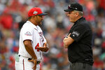 "FILE - In this April 28, 2018, file photo, Washington Nationals manager Dave Martinez, left, talks with second base umpire Mike Everitt during a pitching change in the 10th inning of the team's baseball game against the Arizona Diamondbacks in Washington. Major League Baseball will start each extra inning this season by putting a runner on second base. This rule has been used since 2018 in the minor leagues, where it created more action and settled games sooner. ""I haven't met anyone so far that likes it,"" Martinez said. (AP Photo/Nick Wass, File)"