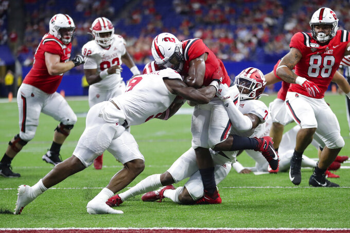 Ball State running back Caleb Huntley (2) is tackled by Indiana defensive back Marcelino Ball (9) and linebacker Reakwon Jones (7) during the first half of a college football game in Indianapolis, Saturday, Aug. 31, 2019. (AP Photo/Michael Conroy)
