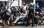 Crew work on the car of Mercedes driver Lewis Hamilton of Britain prior to the qualification session at the Belgian Formula One at Spa-Francorchamps, Belgium, Saturday, Aug. 31, 2019. The Belgian Formula One race will take place on Sunday. (Srdjan Suki, Pool Photo via AP)