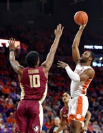 FILE - Clemson's Aamir Simms, right, shoots while defended by Florida State's Malik Osborne during the first half of an NCAA college basketball game in Clemson, S.C., in this Feb. 29, 2020, file photo. Clemson returns senior Aamir Simms, who led the team with 13 points and 7.2 rebounds a game. Simms entered the NBA draft process before choosing to come back for a final year. (AP Photo/Richard Shiro, File)