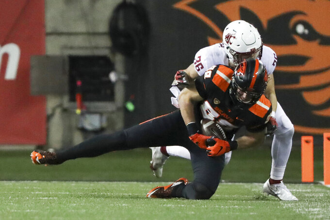 Oregon State tight end Luke Musgrave (88) is brought down by Washington State defensive back Ayden Hector during the first half of an NCAA college football game in Corvallis, Ore., Saturday, Nov. 7, 2020. (AP Photo/Amanda Loman)