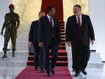 US Secretary of State Mike Pompeo, right, walks with Ethiopian Prime Minister Abiy Ahmed at the Prime Minister's office in Addis Ababa, after a meeting on Tuesday Feb. 18, 2020. Pompeo's visit to Africa is the first by a Cabinet official in 18 months. (Andrew Caballero-Reynolds/Pool via AP)