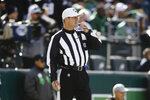 FILE - In this Nov. 3, 2019, file photo, referee Craig Wrolstad (4) works an NFL football game between the Philadelphia Eagles and the Chicago Bears, in Philadelphia. It's been a tough road for Mike Tomlin's Steelers and Joe Judge's Giants heading into a nationally televised Monday night game, Sept. 14. The path has been no easier for NFL officials. (AP Photo/Matt Rourke, File)