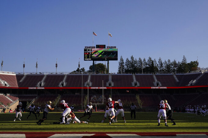 Stanford quarterback Davis Mills (15) passes against Colorado in front of empty seats at Stanford Stadium during the second half of an NCAA college football game in Stanford, Calif., Saturday, Nov. 14, 2020. (AP Photo/Jeff Chiu)