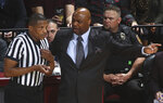 Florida State head coach Leonard Hamilton, center, argues with referee Ted Valentine, left, in the first half of an NCAA college basketball game against Notre Dame in Tallahassee, Fla., Monday, Feb. 25, 2019. (AP Photo/Phil Sears)