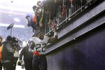 Tennessee Titans running back Derrick Henry leaves the field after winning an NFL wild-card playoff football game against the New England Patriots, Saturday, Jan. 4, 2020, in Foxborough, Mass. (AP Photo/Steven Senne)