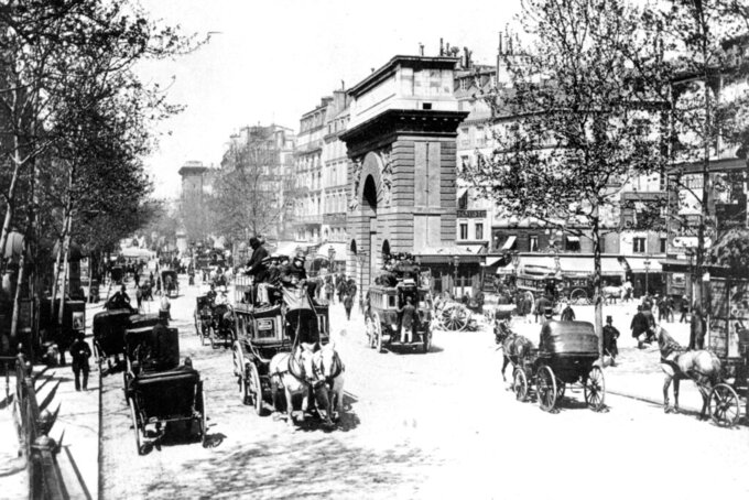 FILE - This 1900 file photo shows the eastern part of a busy boulevard in Paris, France in the year 1900. No opening ceremony. No closing ceremony. And many of the athletes at the 1900 Paris Games had no idea they even competed at the Olympics. But the second edition of the Olympics had female athletes competing for the first time. (AP Photo/File)