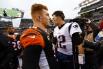 Cincinnati Bengals quarterback Andy Dalton, left, and New England Patriots quarterback Tom Brady (12) meet on the field after an NFL football game, Sunday, Dec. 15, 2019, in Cincinnati. (AP Photo/Frank Victores)