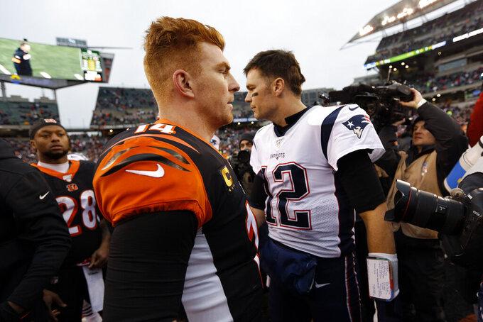 Cincinnati Bengals quarterback Andy Dalton, left, and New England Patriots quarterback Tom Brady (12) meet on the field after an NFL football game, Sunday, Dec. 15, 2019, in Cincinnati. (AP Photo/Frank Victores)