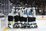 San Jose Sharks players celebrate after defeating the Vegas Golden Knights during the second overtime in Game 6 of a first-round NHL hockey playoff series Sunday, April 21, 2019, in Las Vegas. (AP Photo/John Locher)