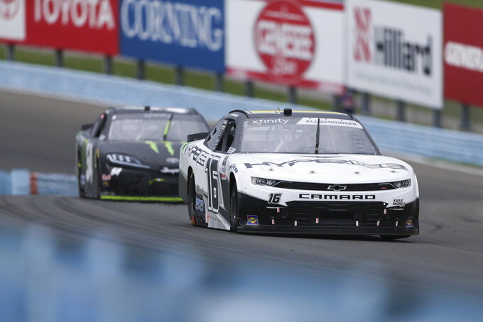 AJ Allmendinger (16) and Ty Gibbs drive through the Esses in the NASCAR Xfinity Series auto race at Watkins Glen International in Watkins Glen, N.Y., on Saturday, Aug. 7, 2021. (AP Photo/Joshua Bessex)